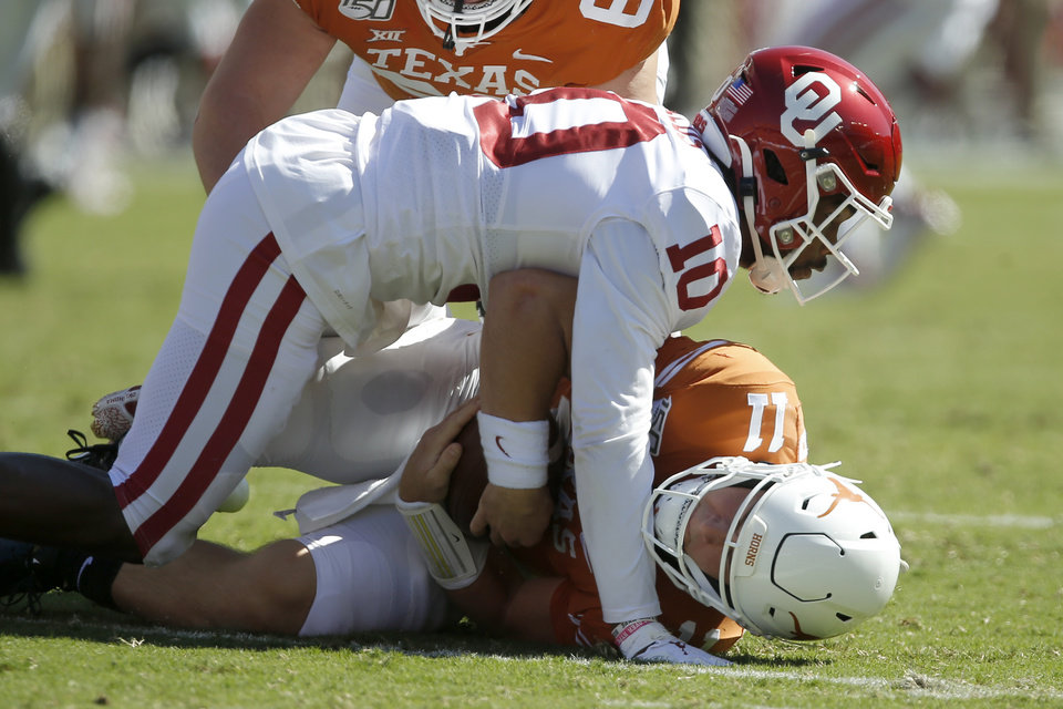 Record - Oklahoma security Pat Fields (10) brings down Texas quarterback Sam Ehlinger (eleven) at some point soon of the Crimson River Showdown college football sport between the University of Oklahoma Sooners (OU) and the Texas Longhorns (UT) at Cotton Bowl Stadium in Dallas, Saturday, Oct. 12, 2019. [Bryan Terry/The Oklahoman]