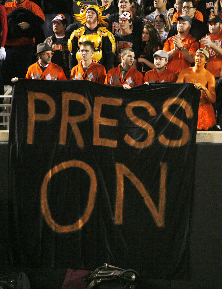 "OSU fans hold a banner that reads ""Press On"" before the college football game between the Oklahoma State University Cowboys (OSU) and the University of Texas Longhorns (UT) at Boone Pickens Stadium in Stillwater, Okla., Saturday, Oct. 31, 2009. Photo by Nate Billings, The Oklahoman"