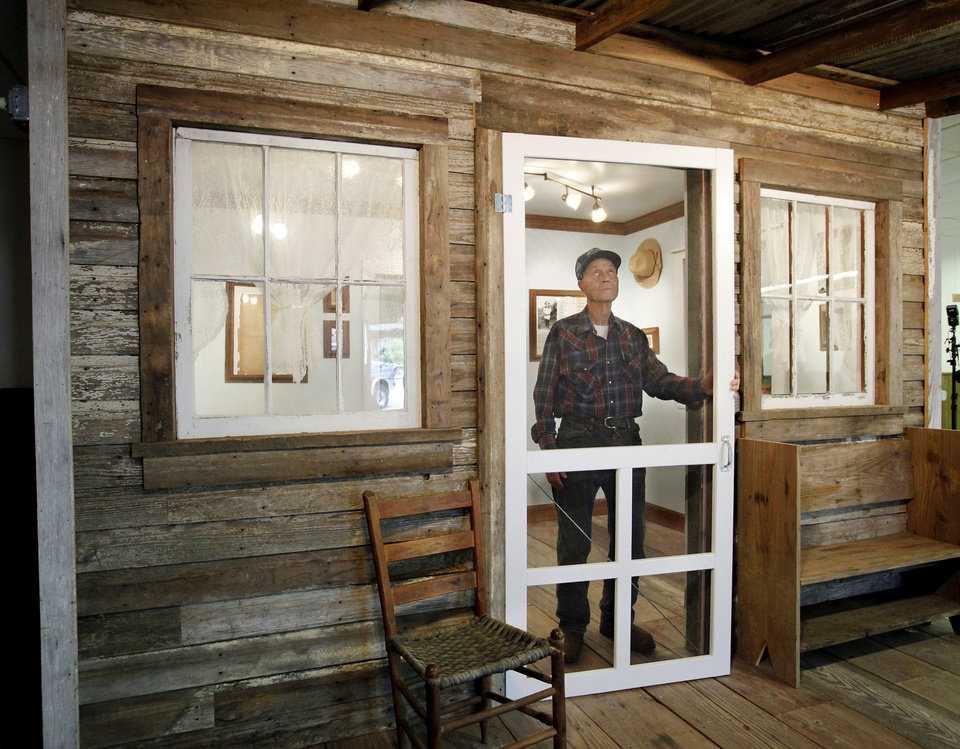 Photo - J. D. Crosby, tour guide at the museum, inside a replica of the  Woody Guthrie