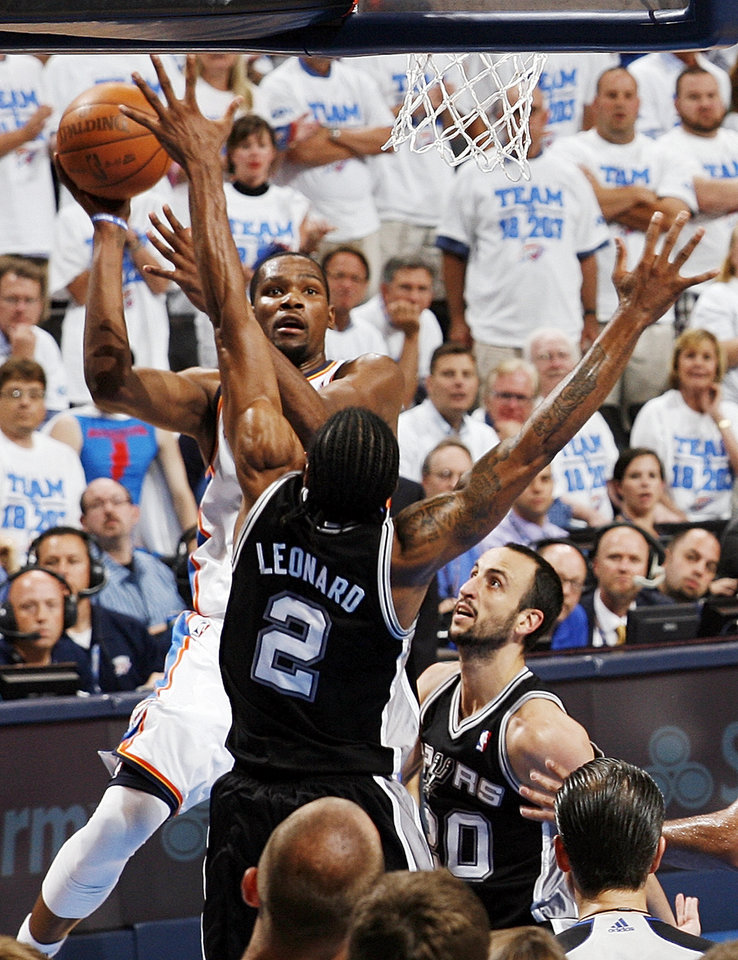 Oklahoma City\'s Kevin Durant (35) shoots against San Antonio\'s Kawhi Leonard (2) and Manu Ginobili (20) in the fourth quarter during Game 4 of the Western Conference Finals between the Oklahoma City Thunder and the San Antonio Spurs in the NBA playoffs at the Chesapeake Energy Arena in Oklahoma City, Saturday, June 2, 2012. Oklahoma City won, 109-103. Photo by Nate Billings, The Oklahoman