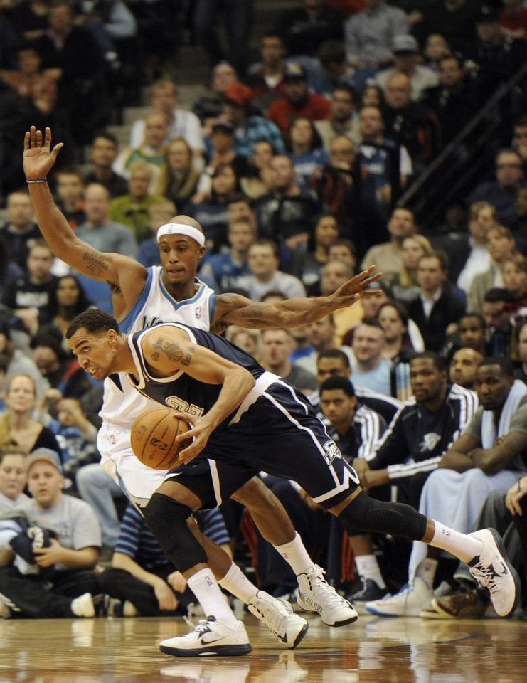 Photo - Oklahoma City Thunder's Thabo Sefolosha, of Switzerland, drives against Minnesota Timberwolves' Dante Cunningham during the second quarter of an NBA basketball game at the Target Center on Thursday, Dec. 20, 2012, in Minneapolis. (AP Photo/Hannah Foslien)