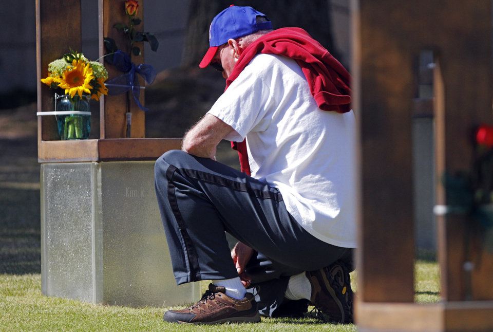 Photo -  Larry Dillow pauses for a moment to remember his daughter Kim Cousins at the 19th anniversary Remembrance Ceremony at the Oklahoma City National Memorial Saturday morning, April 19, 2014, to honor the memory of the 168 victims killed in the 1995 bombing of the Murrah Federal Building. Photo by KT King, The Oklahoman