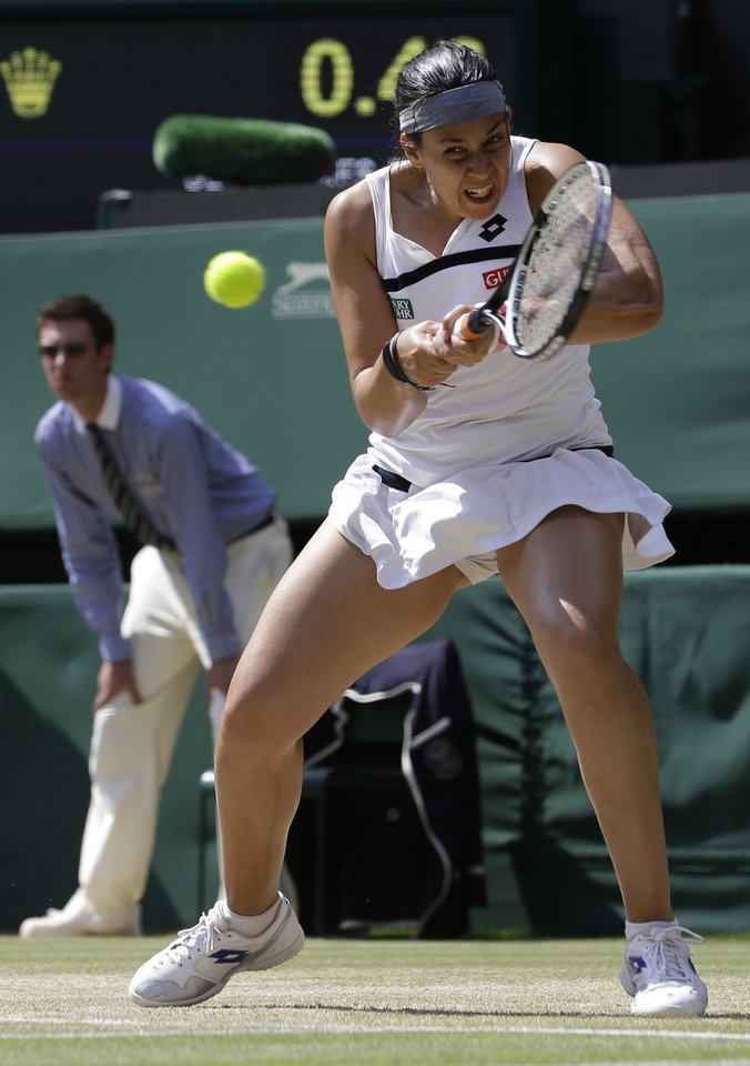 Photo - Marion Bartoli of France returns to Sabine Lisicki of Germany during their Women's singles final match at the All England Lawn Tennis Championships in Wimbledon, London, Saturday, July 6, 2013. (AP Photo/Anja Niedringhaus)