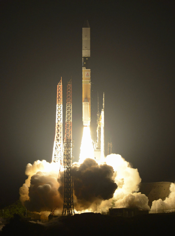 Photo -   A H-2A rocket lifts off from the Japan Aerospace Exploration Agency's Tanegashima Space Center on Tanegashima Island in Kagoshima Prefecture, southwestern Japan, early Friday, May 18, 2012. JAXA and Mitsubishi Heavy Industries Ltd. successfully launched a South Korean satellite into space aboard the rocket, local media said. (AP Photo/Kyodo News) JAPAN OUT, MANDATORY CREDIT, NO LICENSING IN CHINA, HONG KONG, JAPAN, SOUTH KOREA AND FRANCE
