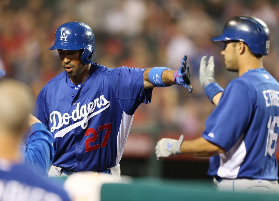 Los Angeles Dodgers' Matt Kemp is congratulated by Andre Ethier after scorin on a sacrifice fly by Ethier in the eighth inning of an exhibition baseball game against the Los Angeles Angels in Anaheim, Calif., on Thursday, March 28, 2013.  (AP Photo/Christine Cotter)