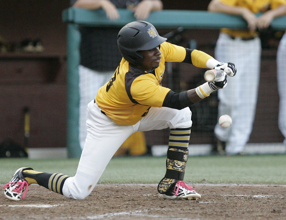 Photo - Kennesaw State's Cornell Nixon lays down a bunt against Georgia Southern in the fourth inning of an NCAA regional college baseball game on Saturday, May 31, 2014, in Tallahassee, Fla. (AP Photo/Steve Cannon)