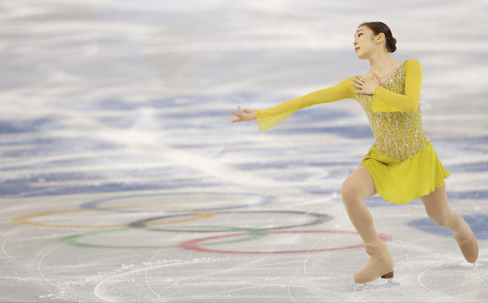 Photo - Yuna Kim of South Korea competes in the women's short program figure skating competition at the Iceberg Skating Palace during the 2014 Winter Olympics, Wednesday, Feb. 19, 2014, in Sochi, Russia. (AP Photo/Vadim Ghirda)