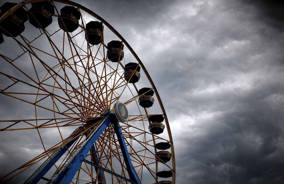 Photo - A Ferris wheel is pictured at the Oklahoma State Fair at State Fair Park, Sunday, Sept. 20, 2015. Photo by Sarah Phipps, The Oklahoman