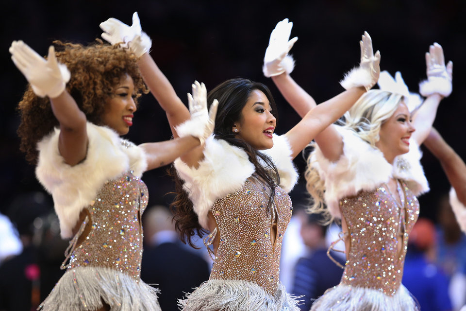 Photo - The Knicks City Dancers perform during the first half of an NBA basketball game between the New York Knicks and the Oklahoma City Thunder at Madison Square Garden, Wednesday, Dec. 25, 2013, in New York. The Thunder won 123-94. (AP Photo/John Minchillo)