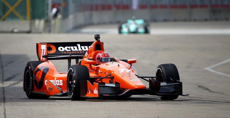 Photo - Simon Pagenaud, of France, drives through the course during a practice session for the IndyCar Grand Prix of Houston auto race Friday, June 27, 2014, in Houston. (AP Photo/David J. Phillip)