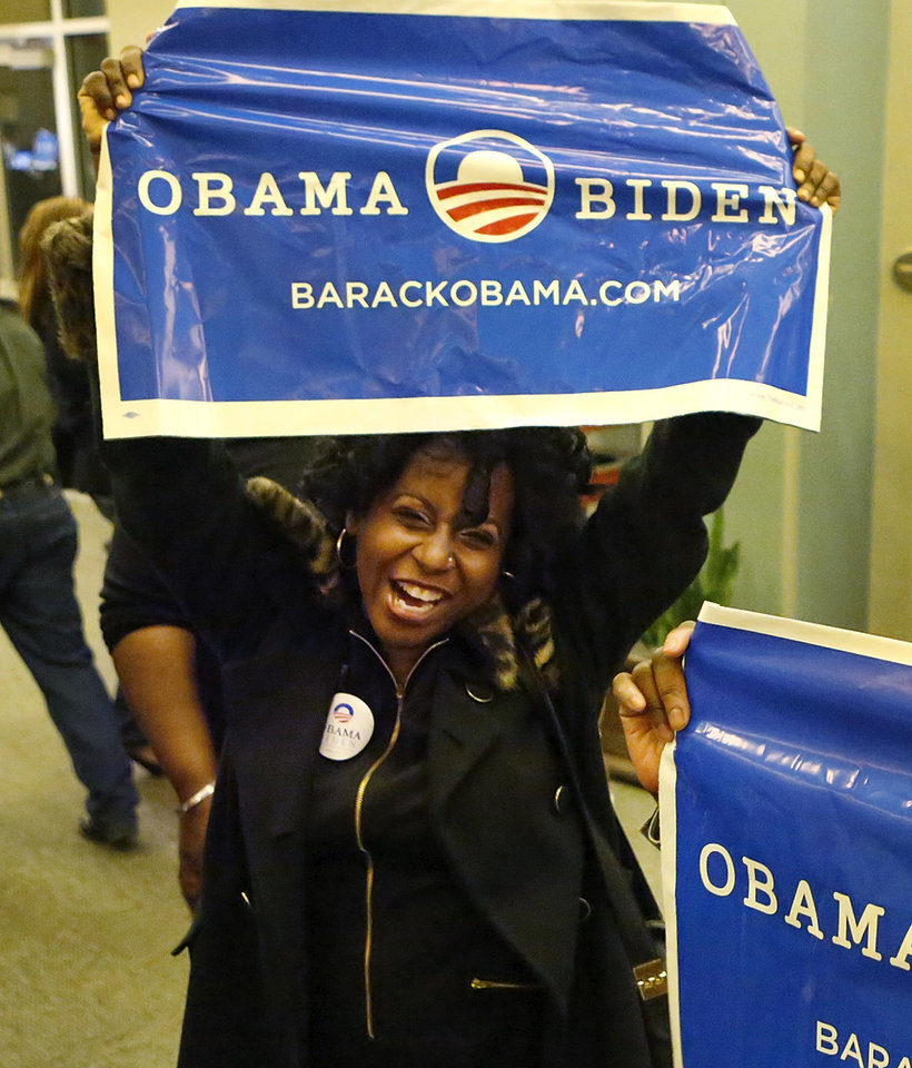 A woman celebrates Obama's re-election victory. About 500 jubilant supporters of President Barrack Obama cheered,  danced , hugged and sang when it was announced that the president had been re- elected Tuesday night, Nov. 6, 2012. The Democrats held their watch party at the Reed Conference Center in Midwest City.    Photo by Jim Beckel, The Oklahoman