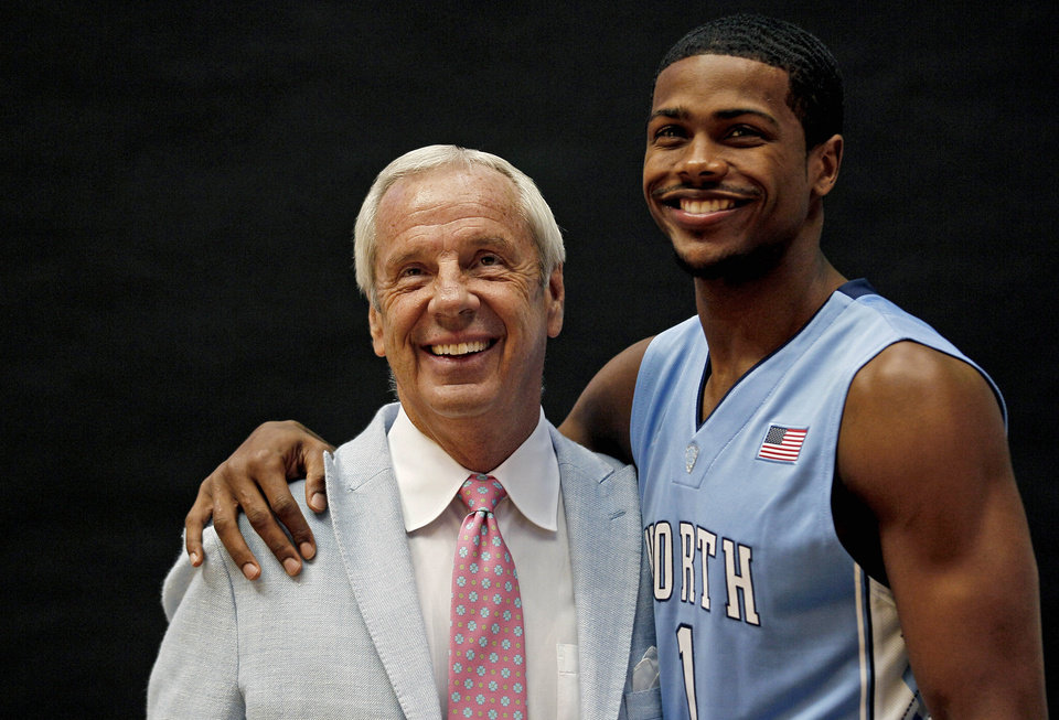 North Carolina coach Roy Williams and Dexter Strickland pose during the team's NCAA college basketball media day in Chapel Hill, N.C., Thursday, Oct. 11, 2012. (AP Photo/Gerry Broome)