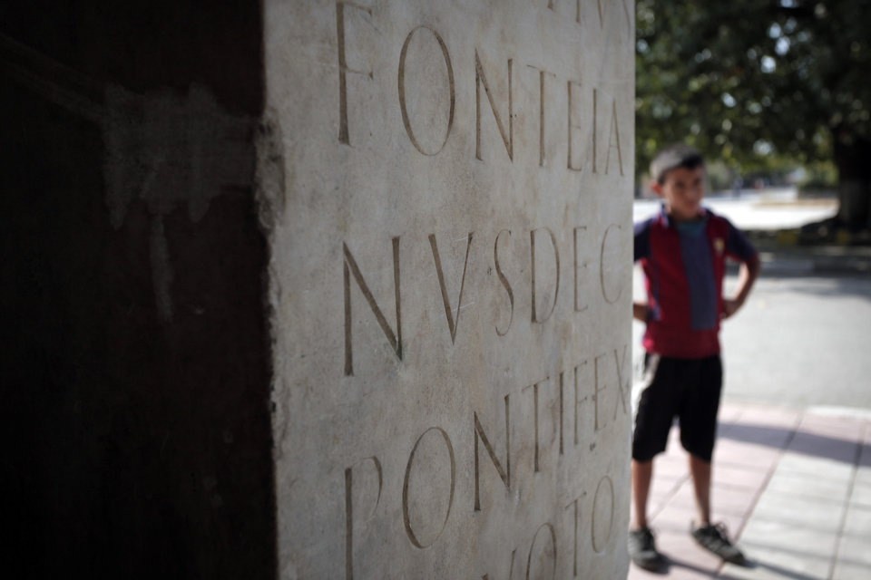Photo -   This Friday, Oct. 5, 2012 photo shows part of ancient Roman inscription on a column, found on the site of Ratiaria, an ancient Roman settlement located on the banks of the Danube, in the northwest corner of Bulgaria. Located on the crossroads of many ancient civilizations, Bulgarian scholars rank their country behind only Italy and Greece in Europe for the numbers of antiquities lying in its soil. But Bulgaria has been powerless to prevent the rape of its ancient sites, depriving the world of part of its cultural legacy and also costing this impoverished Balkan nation much-needed tourism revenue. (AP Photo/Valentina Petrova)