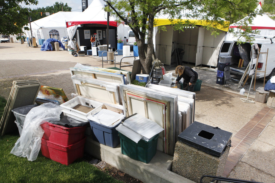 Photo - SET UP / PREPARE: Stacks of art await hanging in preparation for the Festival of the Arts in downtown Oklahoma City, OK, Monday, April 19, 2010. By Paul Hellstern, The Oklahoman ORG XMIT: KOD