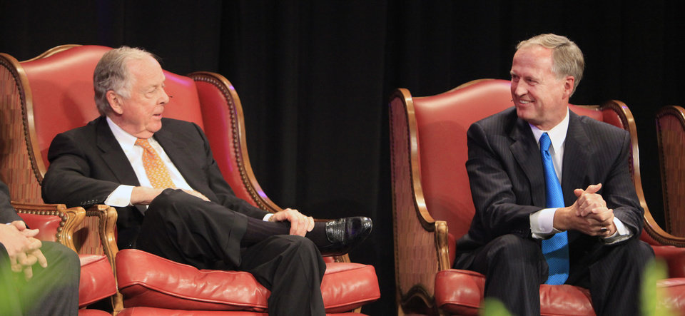 Photo - T. Boone Pickens and John Richels, Devon Energy president, talking during a session titled