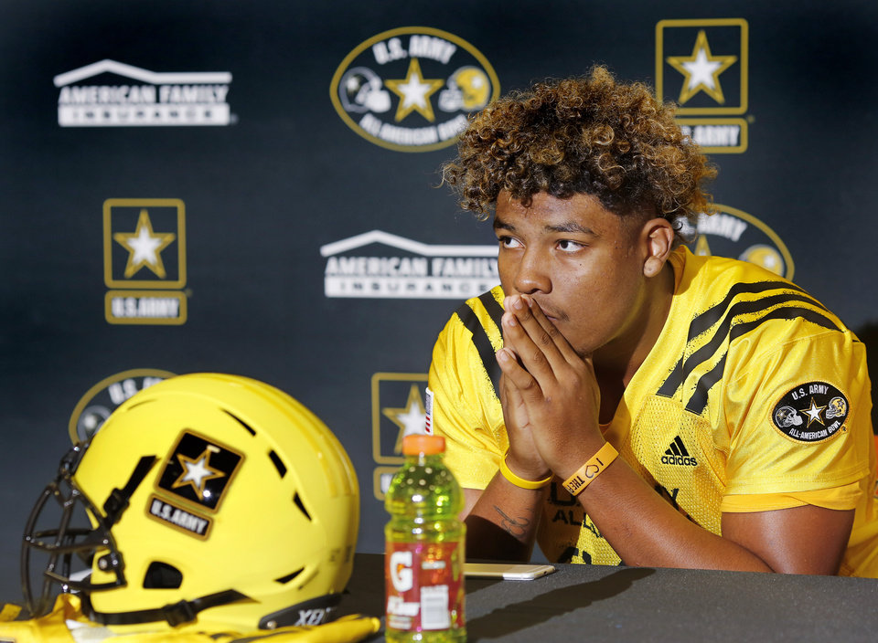 Photo - Putnam City High School football player Ron Tatum III wears his Army All-American jersey after it was presented to him during a ceremony in the school's gym Wednesday, Sep. 20, 2017.   Photo by Jim Beckel, The Oklahoman