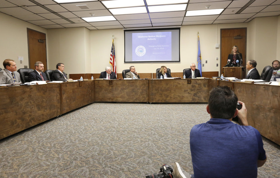 Photo - The Oklahoma State Department of Health voted at their monthly meeting Tuesday morning, July 10, 2018, to ban sales of smokeable forms of medical marijuana and to require dispensaries to hire a pharmacist. The Board of Health voted on 75 pages of rules creating a rough framework for patients, physicians, caretakers and business owners interested in medical marijuana. The ban on sales of leaves and flowers for smoking and the requirement to hire a pharmacist weren't in the draft rules presented to the board, but were a priority of a coalition of medical groups. Julie Ezell, the Health Department's general counsel, presented the rules to a packed board room and to members of the public watching in an overflow room and online. She cautioned board members that the two new rules they added might not be allowed under the state question, inviting a court challenge. Photo by Jim Beckel, The Oklahoman