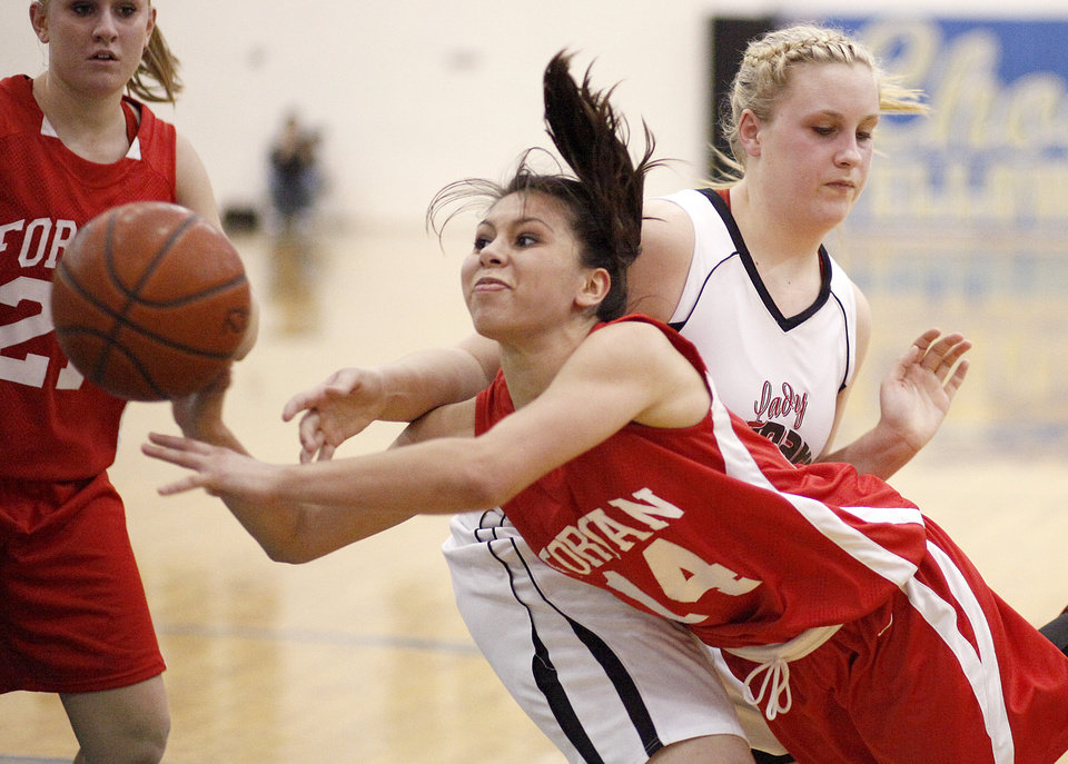 Photo - Forgan's Miranda Lopez tries to get around Caney's  goes between Caney's Macie Crites during the Class B girls state basketball tournament at Choctaw High School in Choctaw, Okla., Thursday, March 4, 2010.  Photo by Bryan Terry, The Oklahoman