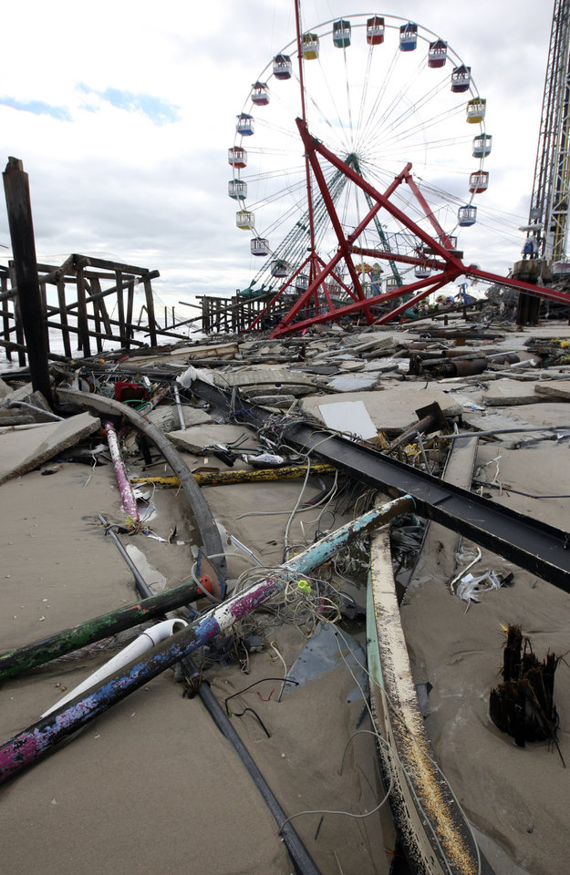 Photo -   The Fun Town Pier in Seaside Heights, N.J. was heavily damaged by superstorm Sandy. (Photo by David Gard/The Star-Ledger, POOL)