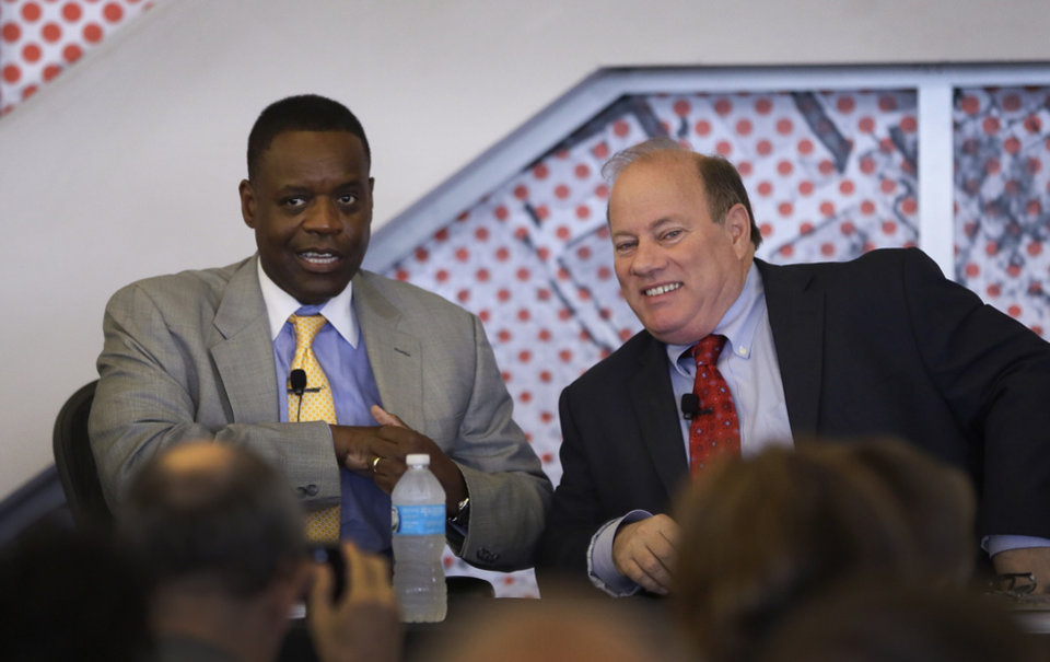 Photo - State-appointed Emergency Manager Kevyn Orr, left, and Mayor Mike Duggan are seen during a news conference in Detroit, Tuesday, May 27, 2014. Removing blighted residential properties, lots and vacant commercial structures that have plagued Detroit neighborhoods for decades would cost $850 million, a task force said Tuesday. Blight has