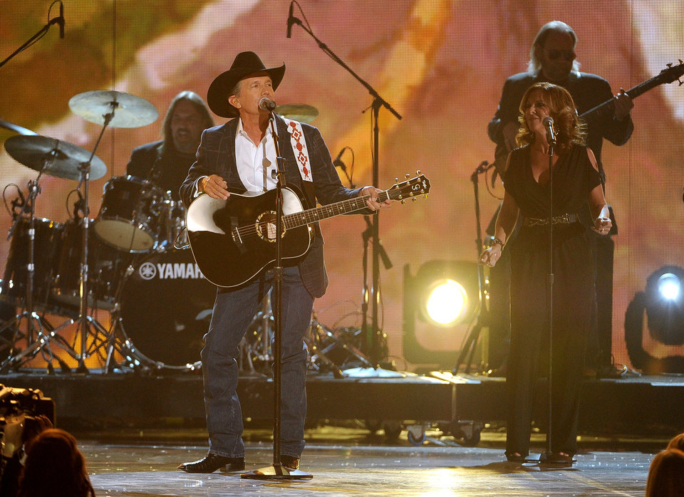 Photo - George Strait performs on stage at the 49th annual Academy of Country Music Awards at the MGM Grand Garden Arena on Sunday, April 6, 2014, in Las Vegas. (Photo by Chris Pizzello/Invision/AP)