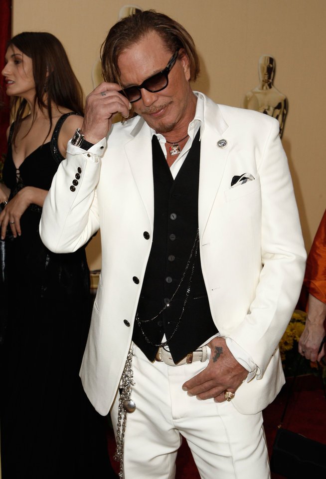 Photo - ** LINDA MILLER'S COMMENTARY:       For Mickey Rourke, it works. He's an original. ** Best Actor in a Leading Role nominee Mickey Rourke arrives for the 81st Academy Awards Sunday, Feb. 22, 2009, in the Hollywood section of Los Angeles. (AP Photo/Matt Sayles) ORG XMIT: CAES127
