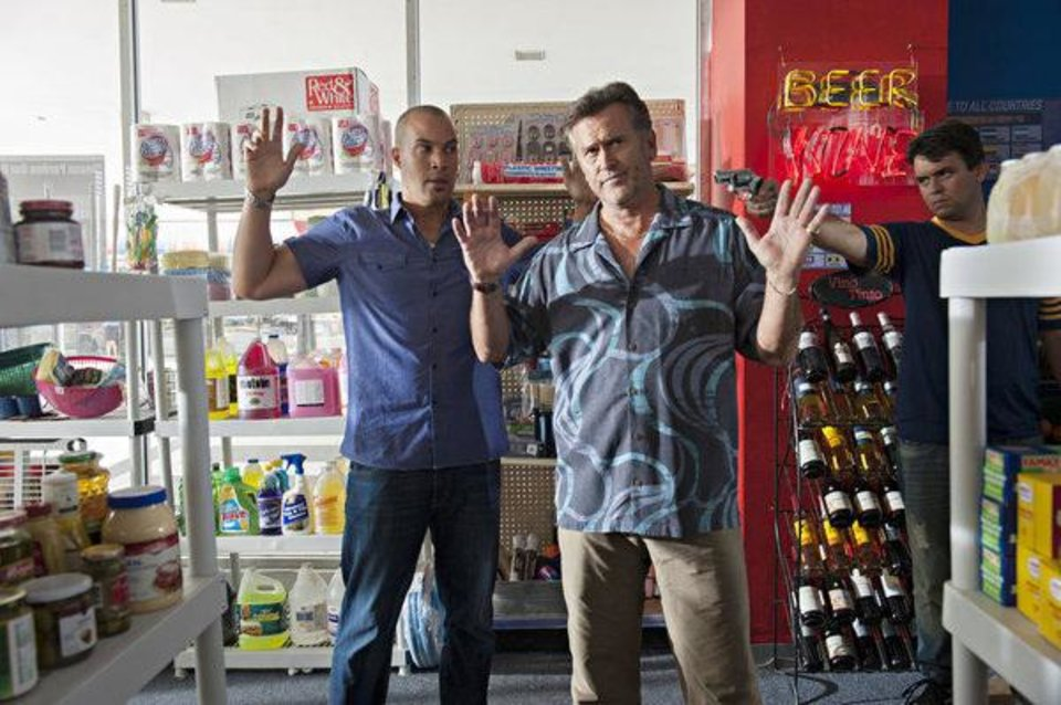 """BURN NOTICE -- """"Reckoning"""" Episode 713 --Pictured: (l-r) Coby Bell as Jesse Porter, Bruce Campbell as Sam Axe -- (Photo by Glenn Watson/USA Network)"""