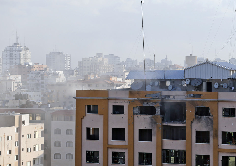 Photo - The damaged top floor of a building that was hit by an Israeli missile strike, is seen in Gaza City, in northern Gaza strip, Friday, July 18, 2014. The heavy thud of tank shells, often just seconds apart, echoed across the Gaza Strip early Friday as thousands of Israeli soldiers launched a ground invasion, escalating a 10-day campaign of heavy air bombardments to try to destroy Hamas' rocket-firing abilities and the tunnels militants use to infiltrate Israel. (AP Photo/Lefteris Pitarakis)