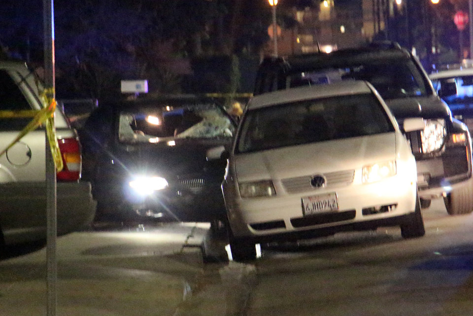 "In this image provided by KEYT-TV, a car window is shot out after a mass shooting near the campus of the University of Santa Barbara in Isla Vista, Calif., Friday, May 23, 2014.  A drive-by shooter went on a ""mass murder"" rampage near the Santa Barbara university campus that left seven people dead, including the attacker, and seven others wounded, authorities said Saturday. (AP Photo/KEYT, John Palminteri)"
