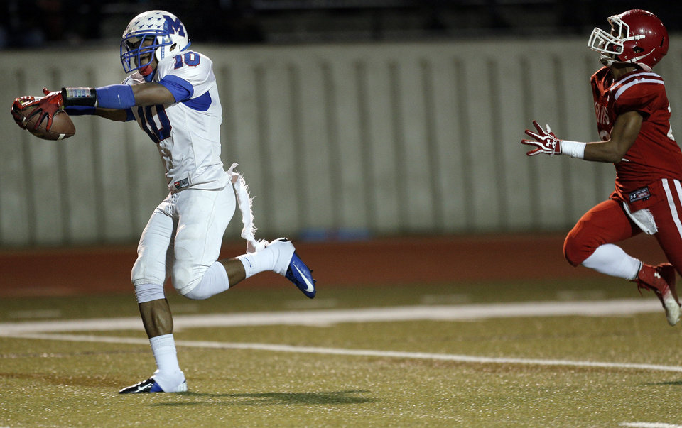 Photo - Millwood's Alfonzo McMillian celebrates a touchdown as Davis' Peyton Ross chases him down during the Class 2A state football championship game between Davis and Millwood at Moore High School in Moore, Okla.,  Thursday, Dec. 19, 2013. Photo by Sarah Phipps, The Oklahoman