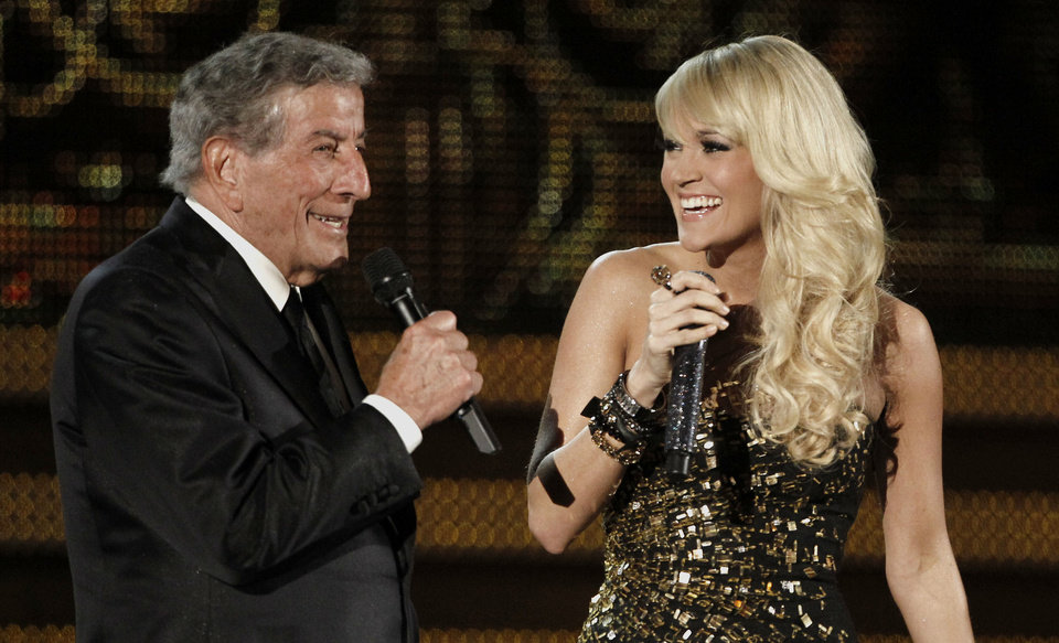 Tony Bennett, left, and Carrie Underwood perform during the 54th annual Grammy Awards on Sunday, Feb. 12, 2012 in Los Angeles. (AP Photo/Matt Sayles) ORG XMIT: CASH415
