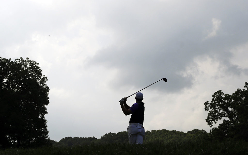 Photo - Rory McIlroy, of Northern Ireland, watches his tee shot on the second hole during the final round of the PGA Championship golf tournament at Valhalla Golf Club on Sunday, Aug. 10, 2014, in Louisville, Ky. (AP Photo/John Locher)
