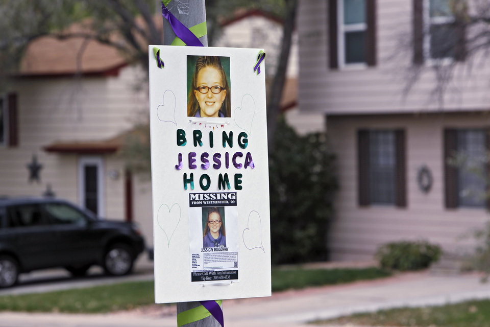 Photo -   A missing person sign is posted on a lamp post near the home of ten-year-old Jessica Ridgeway where police continue to search for the missing girl in Westminster, Colo., on Wednesday, Oct. 10, 2012. The youngster has been missing since she left her home Friday morning on her way to school. (AP Photo/Ed Andrieski)