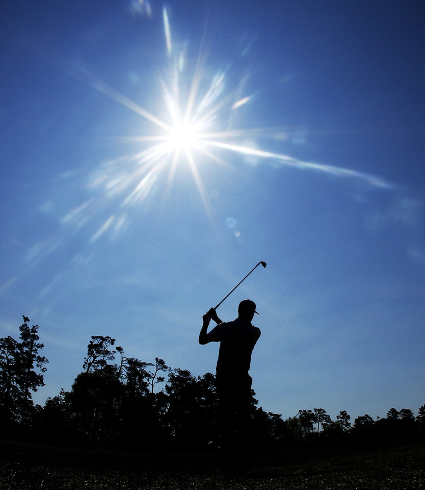 Photo - Chris Kirk hits off the fifth fairway during the second round of the Masters golf tournament Friday, April 11, 2014, in Augusta, Ga. (AP Photo/Matt Slocum)