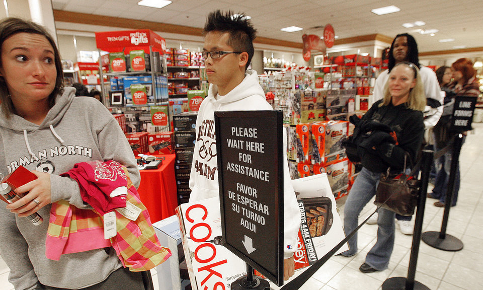 Photo - Black Friday. Line of shoppers wait to check out at the J.C. Penney's in Penn Square Mall, Friday, November 27, 2009. The doors opened at 4:00 A.M. By David McDaniel, The Oklahoman.
