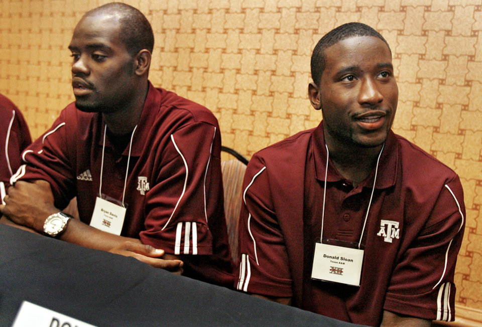 COLLEGE BASKETBALL: Texas A&M University\'s Bryan Davis and Donald Sloan, from left, talk to the press during the Big 12 Men\'s Basketball Media Day at the Cox Convention Center on Thursday, Oct. 23, 2008, in Oklahoma City, Okla. BY CHRIS LANDSBERGER, THE OKLAHOMAN ORG XMIT: KOD