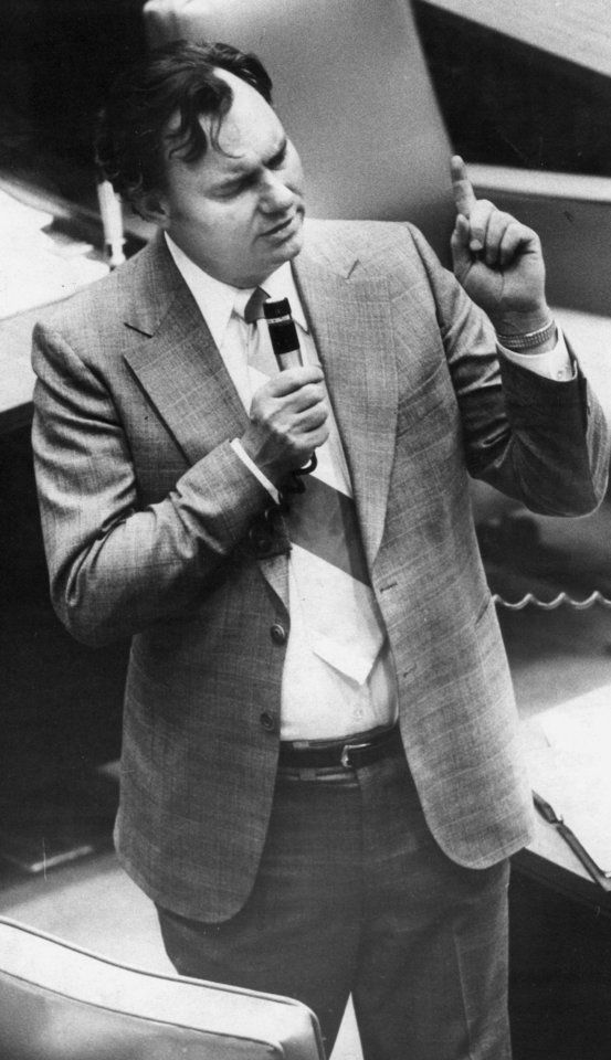 Photo - State Senator Gene Stipe, D-McAlester, ponders a point during a debate on a bill on the floor of the State Senate Chamber at the state capitol.  Staff photo by Paul B. Southerland taken 3/21/78; photo ran in the 6/11/78 Daily Oklahoman.