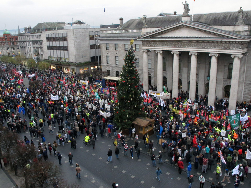 Thousands of anti-austerity protesters rally outside Dublin's General Post Office to hear speeches opposing government plans for more spending cuts and tax rises Saturday, Nov. 24, 2012. The government says it will unveil Ireland's sixth straight austerity budget next month in hopes of reducing the country's 2013 deficit to 8.6 percent, still nearly triple the spending limit that eurozone members are supposed to observe. (AP Photo/Shawn Pogatchnik)