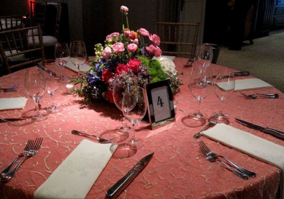 Different heights of centerpieces were on the tables. (Photo by Helen Ford Wallace).