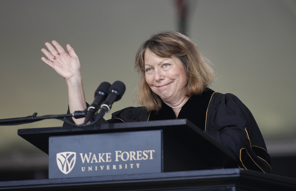 Photo - Jill Abramson, former executive editor of The New York Times, waves as she speaks at the commencement ceremony at Wake Forest University in Winston-Salem,N.C., Monday, May 19, 2014.