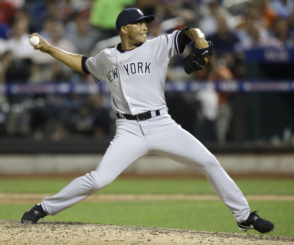 Photo - American League's Mariano Rivera, of the New York Yankees, pitches during the eighth inning of the MLB All-Star baseball game, on Tuesday, July 16, 2013, in New York. (AP Photo/Kathy Willens)
