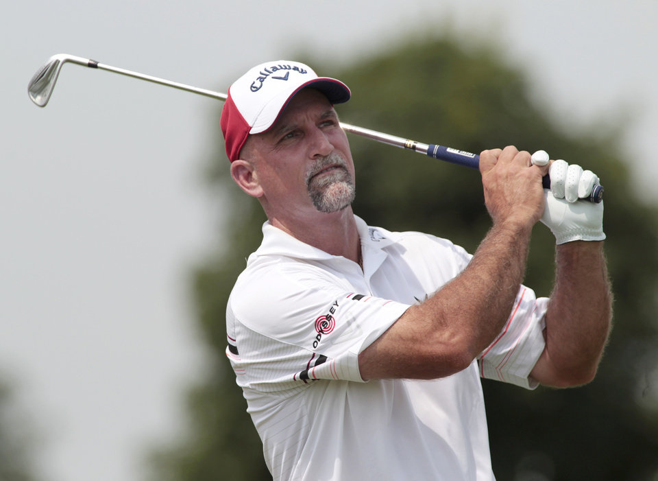 Photo - Marco Dawson hits his drive off the fourth tee during the third round of the Champions Tour 3M Championship golf tournament at TPC Twin Cities in Blaine, Minn., Sunday, Aug. 3, 2014. AP Photo/Paul Battaglia)