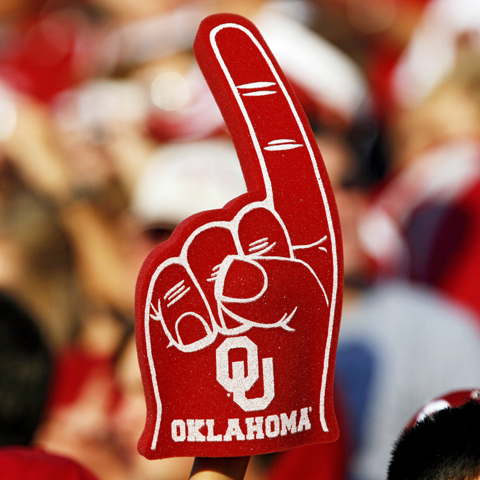 Photo - NO. / NUMBER / 1 / ONE / FOAM FINGER: A Sooner fan holds up a foam number one hand during the first half of the college football game between the University of Oklahoma Sooners (OU) and Texas Christian University Horned Frogs (TCU) at the Gaylord Family -- Oklahoma Memorial Stadium on Saturday, Sept 27,  2008, in Norman, Okla.  by Chris Landsberger, The Oklahoman ORG XMIT: KOD