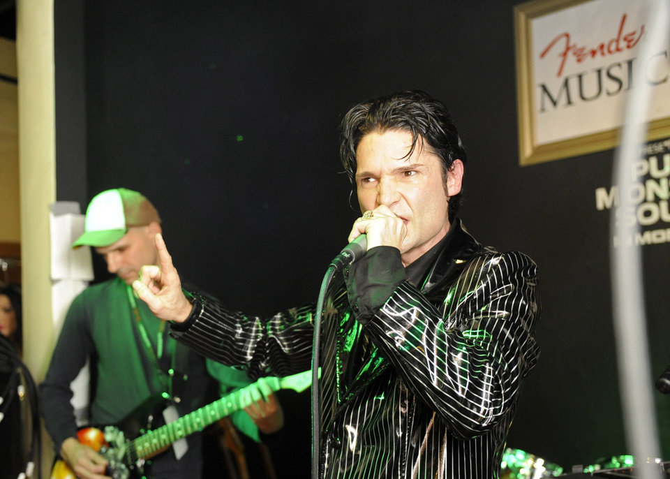 Photo - IMAGE DISTRIBUTED FOR FENDER - Corey Feldman performs at the Fender Music lodge during the Sundance Film Festival on Saturday, Jan. 19, 2013, in Park City, Utah. (Photo by Jack Dempsey/Invision for Fender/AP Images)