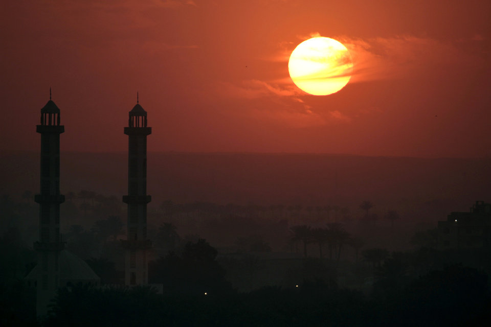 Photo - A Mousque silhouetted against sunset in Cairo, Egypt, Monday, Dec. 31, 2012. (AP Photo/Amr Nabil)