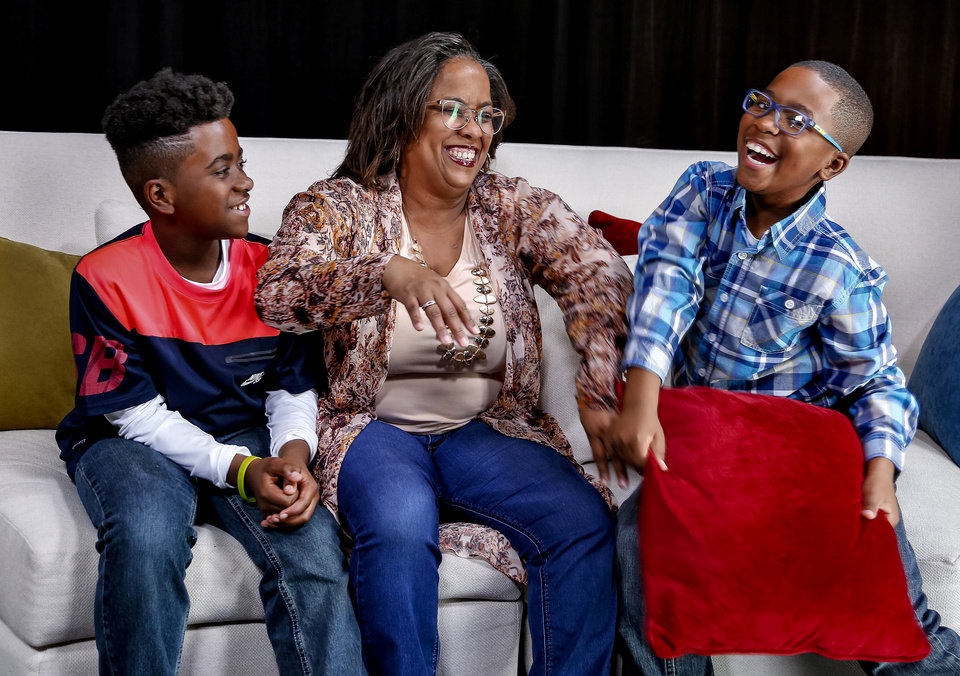 Photo -  Alicia Currin-Moore jokes around with her sons, 10-year-old Mason, left, and 9-year-old Myles, on April 6 in the OPUBCO Studio in Oklahoma City. [Photo by Chris Landsberger, The Oklahoman]