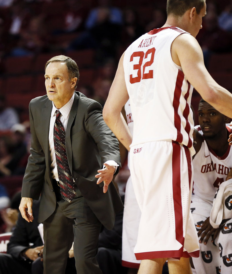 Photo - OU head coach Lon Kruger pats Oklahoma's Casey Arent (32) as he goes to the bench during an NCAA men's basketball game between the University of Oklahoma (OU) and Texas Christian University (TCU) at the Lloyd Noble Center in Norman, Okla., Monday, Feb. 11, 2013. OU won, 75-48. Photo by Nate Billings, The Oklahoman