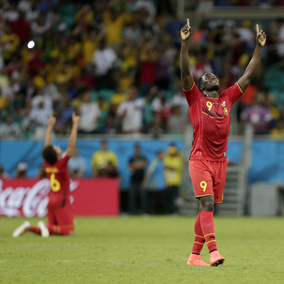 Photo - Belgium's Romelu Lukaku celebrates after Belgium defeated the USA 2-1 in extra time to advance to the quarterfinals during the World Cup round of 16 soccer match between Belgium and the USA at the Arena Fonte Nova in Salvador, Brazil, Tuesday, July 1, 2014. Lukaku scored his side's second and winning goal. (AP Photo/Marcio Jose Sanchez)