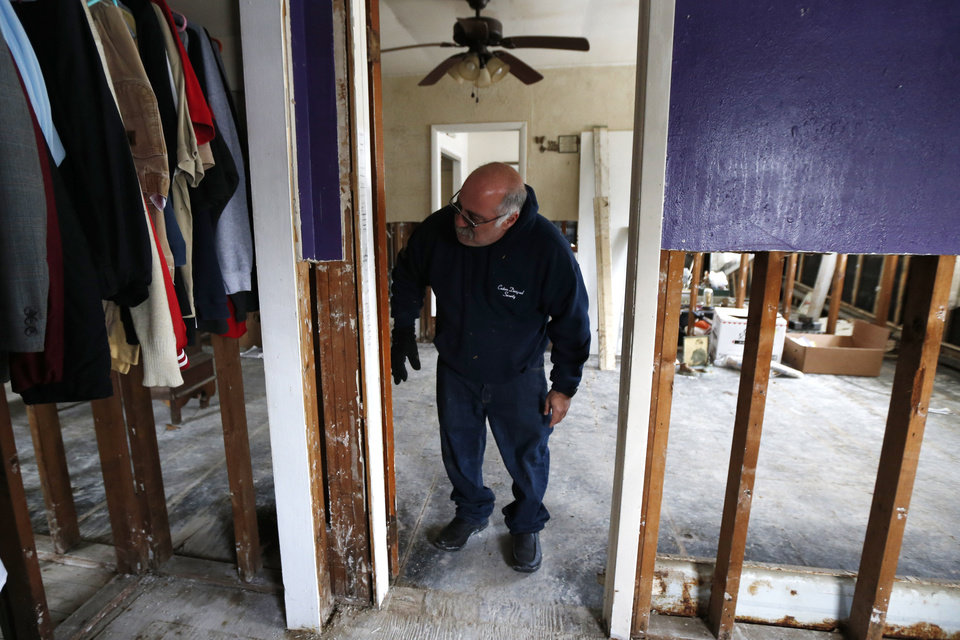 Anthony Cavallo looks at the doorway to the room of his 14-year-old daughter Amy Cavallo, where markings of growth were made throughout the years, Wednesday, Jan. 23, 2013, in Union Beach, N.J. The Cavallo\'s had to buy a trailer out of pocket and place it next to their home damaged by Superstorm Sandy because they\'ve yet to receive storm aid. Cold weather is bringing extra worries to residents of the areas hit by Sandy. The deep freeze will continue into Thursday and Friday. There\'s a chance of snow Friday afternoon and evening, but accumulations are expected to be minor. (AP Photo/Julio Cortez)