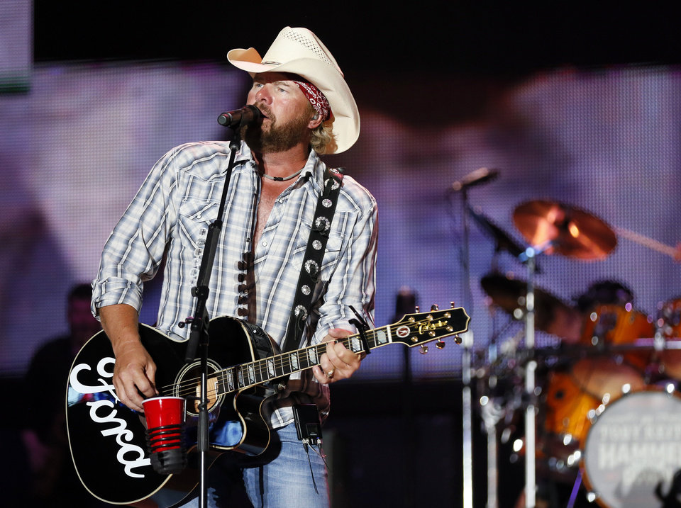 Photo - Toby Keith performs at the end of the Oklahoma Twister Relief Concert, benefiting victims of the May tornadoes, at Gaylord Family - Oklahoma Memorial Stadium on the campus of the University of Oklahoma in Norman, Okla., Saturday, July 6, 2013. Photo by Nate Billings, The Oklahoman
